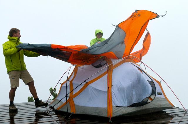 Taking the tent apart on Leading Peak, Anvil Island BC (Canada)