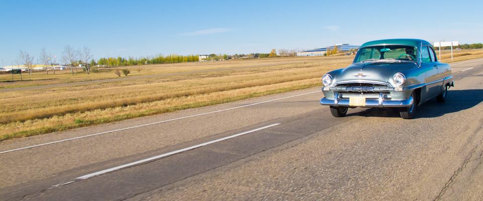Vintage car on road trip across Canada
