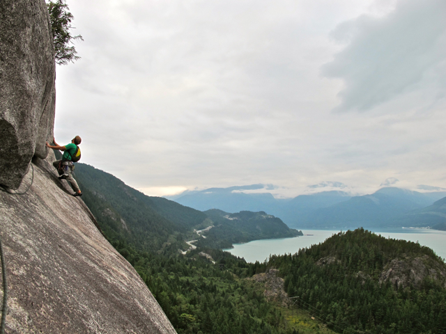 "Alain on the traverse pitch of ""Skywalker"", rock climbing in Squamish BC, Canada"
