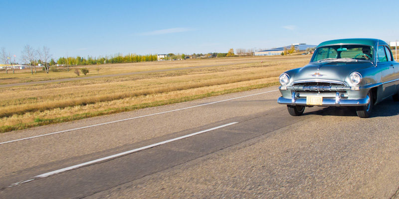 Vintage car on road trip across Canada