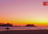 Surfing at sunset in Tofino BC, Canada