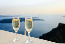 two champagne glasses overlooking the sea in Greece