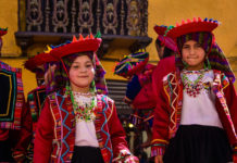 Children at the Pase del Niño parade in Cuenca, Ecuador
