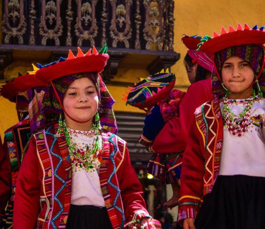Children at the Pase del Niño parade in Cuenca, Ecuador