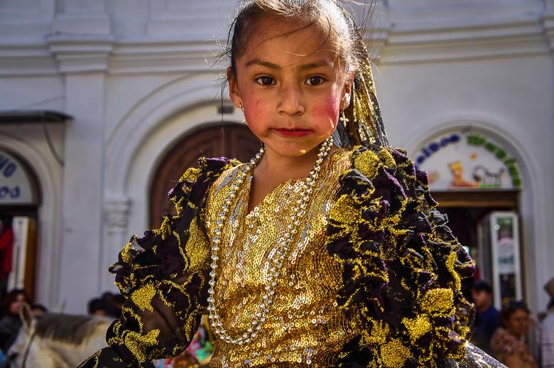 Girl in costume for the Pase del Niño parade in Cuenca, Ecuado