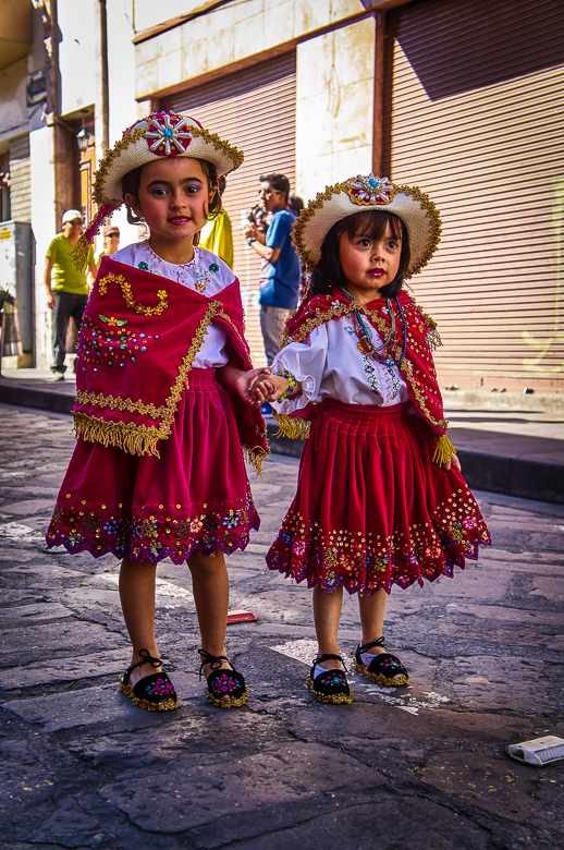 Girls in costume for the Pase del Niño parade in Cuenca, Ecuad