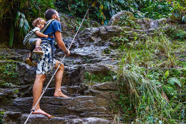 Climbing up at Juan Curi waterfall near San Gil, Colombia