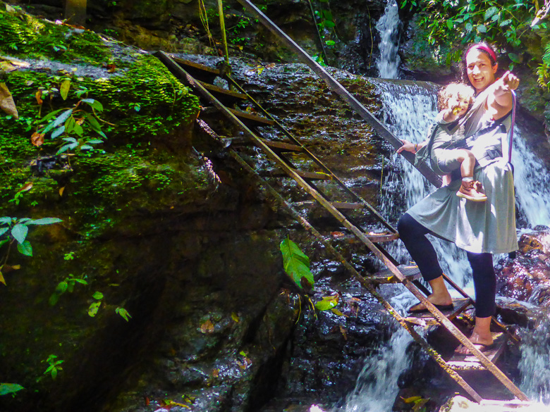 Carrying Ayla to the Juan Curi waterfall in Colombia