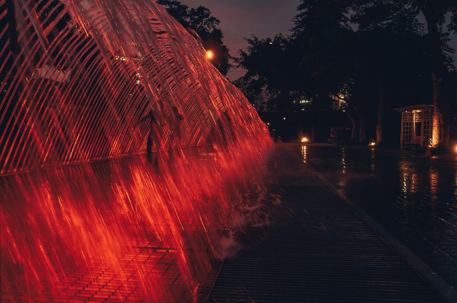 Red tunnel fountain at the Magic Water Circuit in Lima, Peru